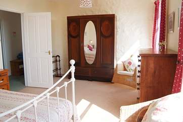 The master bedroom (Bedroom 4) enjoys fabulous sea views from its two large windows and is beautifully furnished.