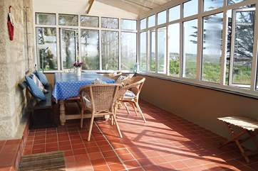 The conservatory is a wonderful place to sit and eat with friends and family whilst enjoying the views.