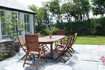 The sunny patio-area is ideal for al fresco meals.