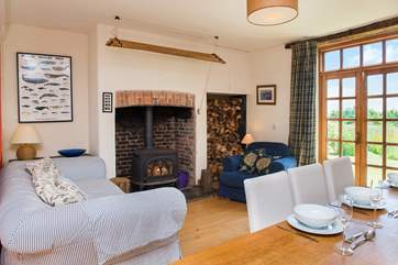 You can enjoy time in front of the wood-burner in the main living-room and watch the cooks at work!