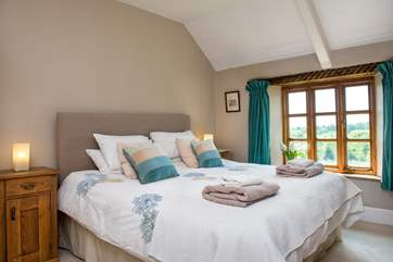 Bedroom1 is beautifully funished and enjoys views over the garden.