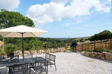 The patio table and chairs are ideally placed for enjoying meals al fresco.
