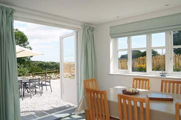 Double doors open out to the gravelled patio garden from the dining and kitchen area.