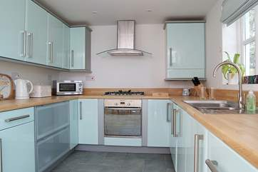 The beautifully fitted pale blue kitchen.
