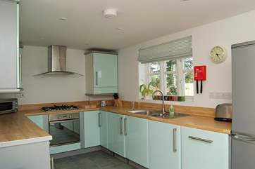 The well-equipped kitchen is at one end of the open plan living-room.