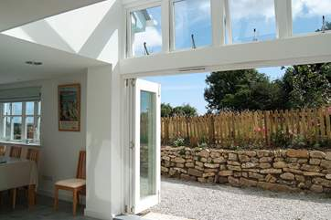 Above the folding doors, windows go right up to the first floor ceiling.