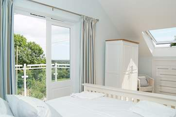 The spacious double bedroom (Bedroom 1) on the first floor has doors opening onto a small balcony (please take care with children).