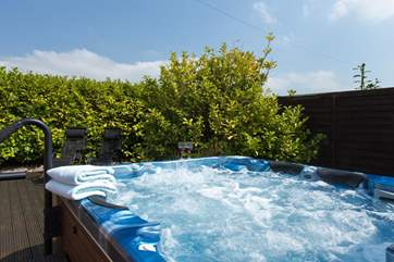 The great treat here is this lovely hot tub - in a very private side garden.