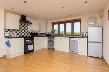 The kitchen is well set out, extremely well-equipped and has unspoilt rural views from the kitchen sink! Not that you have to wash up as of course there is a dishwasher.