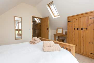 Another view of the double bedroom. There is plenty of storage and additional light from the Velux window.