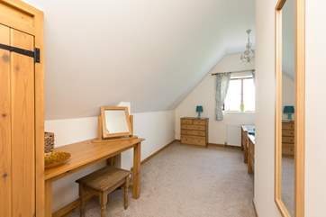 The twin bedroom is in a generous L shape with the beds tucked around the corner.
