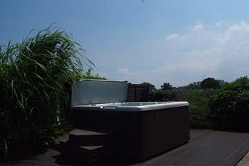 What a setting for the supersize hot tub, in a private garden with countryside views acros the fields.
