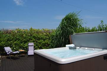 There is a fabulous, very private, supersize hot tub and a garden and patio too, both looking out over fields and country views.