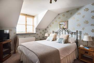 Beautiful wallpapers and soft furnishings throughout the apartment.