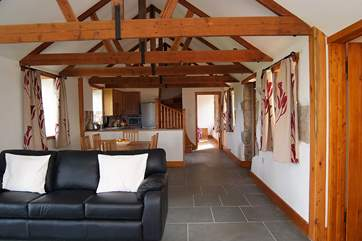 The two ground floor en suite bedrooms are at either end of the living-room.