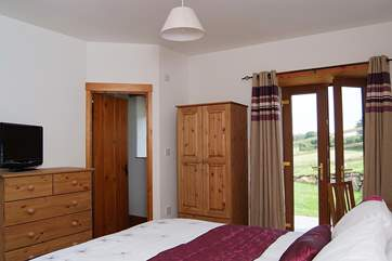 Both ground floor bedrooms have patio doors opening out to the garden.