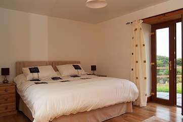 Bedroom 1, on the ground floor, has 'zip and link' (double or twin) beds and a door leading out to the garden.