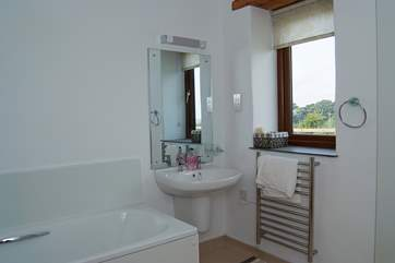 The bathroom (next to Bedroom 1) includes a wet-room shower as well as a bath.