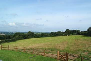 The fabulous view from the first floor bedroom across the field to the countryside and towards Falmouth.