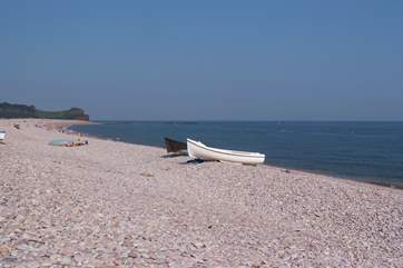 The long stretch of pebbled beach at Budleigh Salterton.
