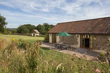 The Old Dairy is a beautiful detached barn conversion in an utterly tranquil setting on the edge of an orchard.
