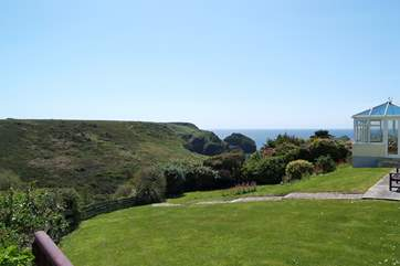 Looking from the end of the patio across the neighbouring garden towards the cove.