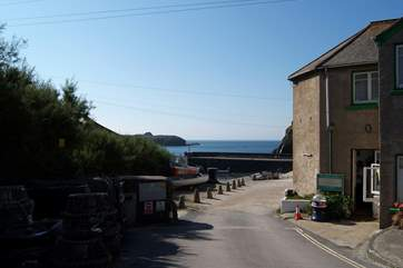 The entrance to the harbour, with the little cafe on the right.