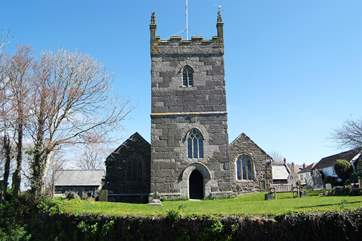 In the centre of Mullion village, the 15th Century church of St Mellanus is renowned for its richly-carved oak bench-ends depicting biblical scenes including one of Jonah and the Whale.