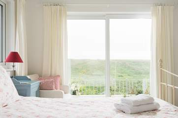 Open up the patio doors and listen to the sea from the comfort of your bed.