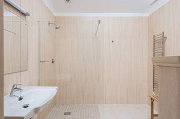 Light and spacious, the gorgeous wet-room is beautifully finished.