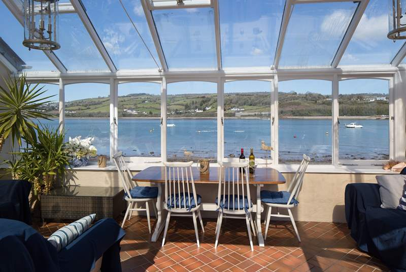 The conservatory sits in the garden wall looking over the estuary.
