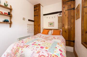 This is the single bedroom, also on the ground floor. The extra-sized (4') single bed is very comfortable for an adult as well as for children.