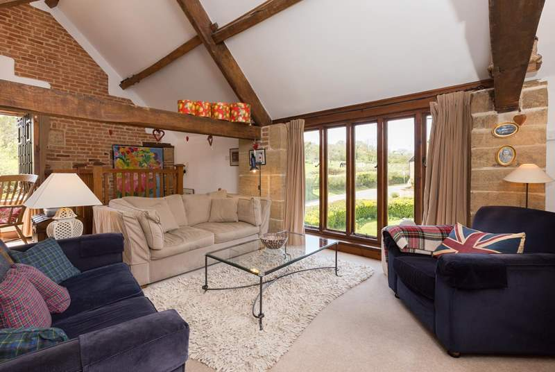 The reverse level accommodation makes the most of the views - the first floor is a lovely open plan space.