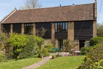 Hayloft is the right-hand end of this lovely barn conversion in the historic National Trust village of Barrington.