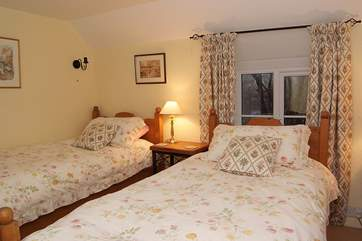 The cosy twin bedroom (Bedroom 3) has dual-aspect windows.