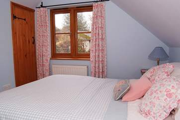Bedroom 2, the double bedroom, overlooks the secluded garden.