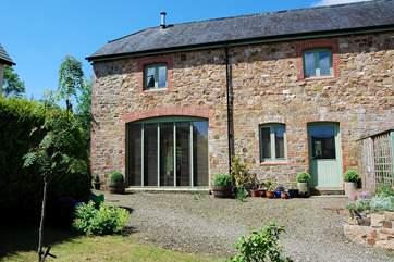 The Garden House is a luxurious modern barn conversion.