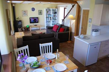 The living-room and kitchen-area are open plan.