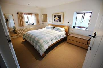 The gorgeous double bedroom is very spacious.