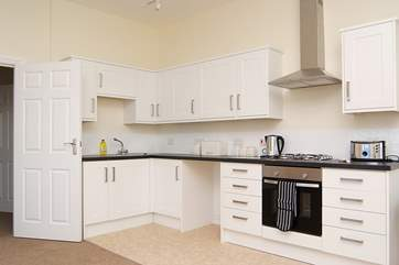 The well-equipped modern kitchen in the open plan living area.
