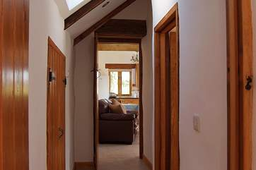 There are two steps from the living-room down to the bedrooms and bathroom.