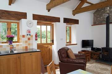 The living-room has a stable-door which opens onto the quiet drive, on the other side of which is the garden.