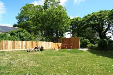 The south-facing 'meadow' garden includes your private sheltered patio and barbecue-area.