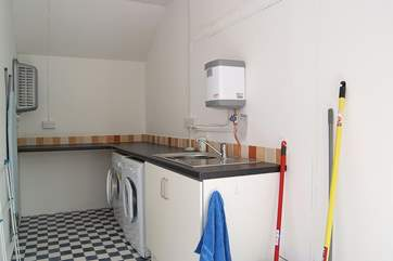 The separate utility-room is located behind the cottage next door. (New photo to follow)