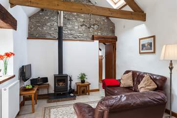 The cosy lounge, with lovely wood burner.