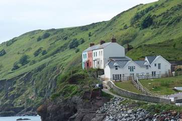 The front door of this unusual property is right on the clifftop (second house in from the left).