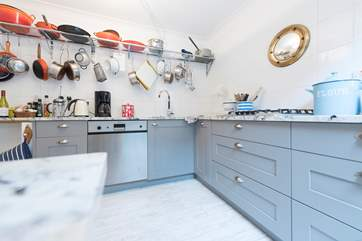 The kitchen is characterful and well equipped.