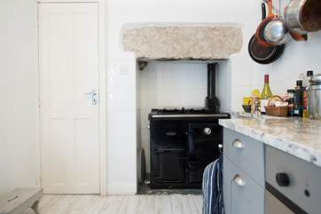 A gas fired Rayburn makes the kitchen homely and warm.