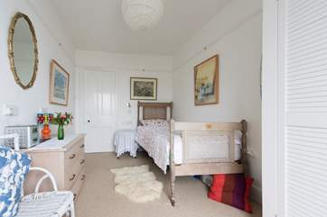 The pretty single bedroom has sea views