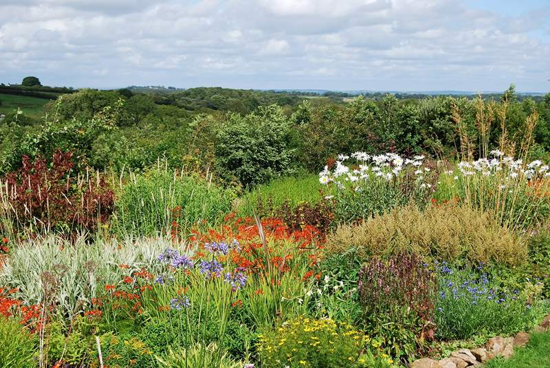 The huge garden has far reaching vistas and drifts of plants.